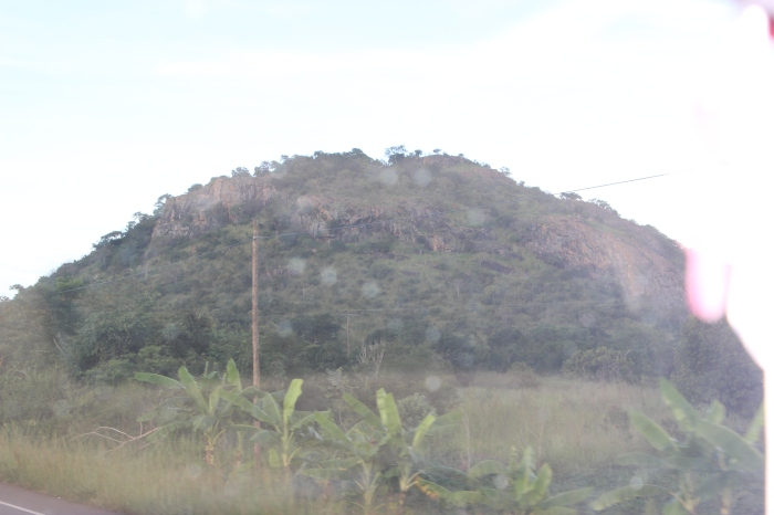 Uganda: Pile of rock = China: Mountain