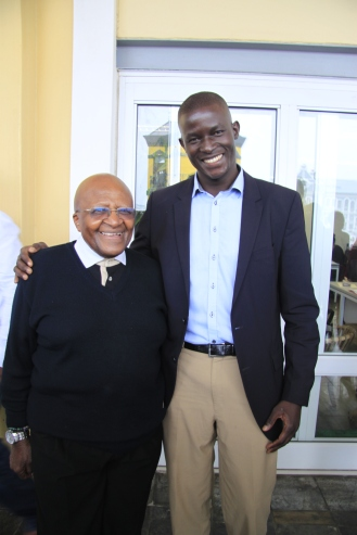 Victor Ochen and-Archbishop-Desmond-Tutu